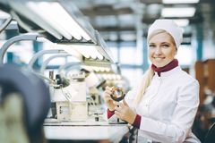 Factory electronics worker. Fix make female smile Stock Photos