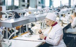 Factory electronics worker. Fix make female smile Royalty Free Stock Photos