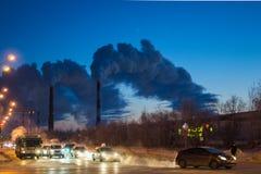 A factory emits smoke stock photography