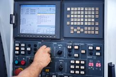 Factory engineer controlling and pressing important technology button at control panel. Factory engineer controlling and pressing important technology button at stock photos