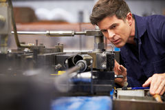 Factory Engineer Operating Hydraulic Tube Bender. Close Up Of A Factory Engineer Operating Hydraulic Tube Bender stock image