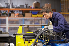 Factory Engineer Operating Hydraulic Tube Bender. Horizontal Image Of A Factory Engineer Operating Hydraulic Tube Bender stock image