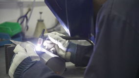 Factory Engineer Operating TIG Welding Machine. Close up of factory engineer using tIG welding machine to join two pieces of metal.Shot on Sony FS700 in PAL stock footage