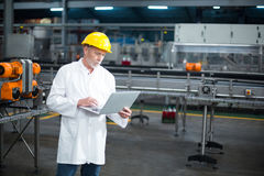 Factory engineer using laptop in the factory royalty free stock photos