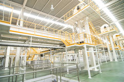 Factory equipment. inside Industrial conveyor line transporting Stock Photos