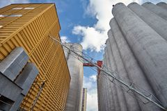 Factory exterior with grain silos Royalty Free Stock Image