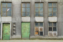 Factory Facade. Windows and doors of a rundown factory stock photo