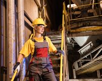 Factory female worker Stock Images