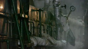 Factory filled with steam.dim light,Valve,Pipeline,Boiler. stock footage