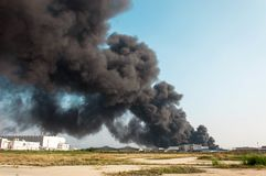 Factory fire burning with black smoke royalty free stock photos