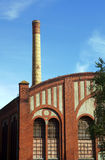 Factory floor and smokestack in old gasworks Royalty Free Stock Photo