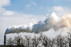 Factory flue and water steam. On a blue sky background royalty free stock images