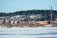 Factory by frozen lake Royalty Free Stock Photography