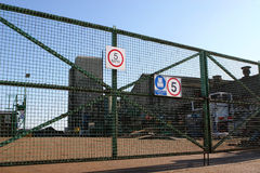 The Factory Gate. Factory gates with warning signs Royalty Free Stock Photography