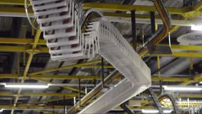 Factory hall with a large offset printing press in a printing plant for the production of printed products such as newspapers and stock video footage