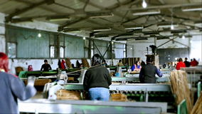 Factory halls and workers for machines stock footage