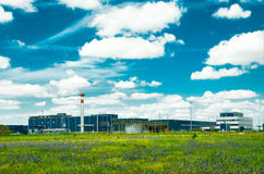 Free Factory In The Middle Of A Green Meadow Royalty Free Stock Photos - 26942418