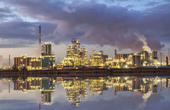 Factory in the industrial area of Antwerp in the evening Stock Photo