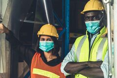 Factory industry worker working with face mask to prevent Covid-19