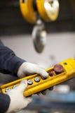 Factory interior crane hook button. Shallow focus Stock Photos