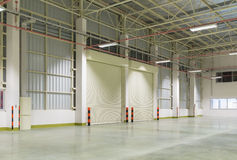 Factory. Interior of factory with shutter door, night time royalty free stock images