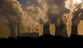 Factory landscape. A factory and power station belching pollution royalty free stock images