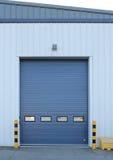 Factory loading bay roller door on industrial building Stock Photos