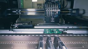 Factory machine is making electronic boards. 4K stock footage