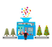 Factory machine for release of beautiful Christmas trees. Tree f Royalty Free Stock Photo