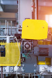 Factory machine with yellow panels. Royalty Free Stock Photo