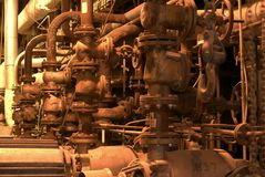 Factory machines and piping. In insulation Royalty Free Stock Image