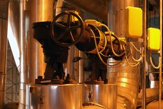 Factory machines and piping. In insulation Stock Photo