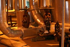 Factory machines and piping. In insulation Stock Image