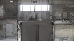 Factory magnet with metal balls, Electromagnetic crane, industrial magnet, production of balls, manufacture of bearings.