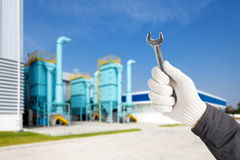Factory maintenance working with wrench Stock Photos