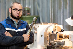 Factory man turner with auger tool Royalty Free Stock Photo