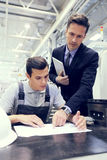 Factory manager and worker Royalty Free Stock Photos