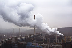 Factory with many smokestacks and big smoke, air pollution Stock Photo