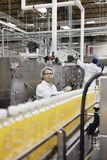 Factory men working in a bottling plant Royalty Free Stock Image