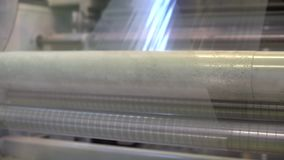 Factory metal rollers spinning and working stock footage