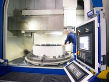 Factory of modern mechanical engineering - production of gearbox. Es for wind turbines - worker at cnc milling machine stock photo