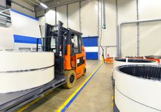 Factory of modern mechanical engineering - production of gearbox. Es for wind turbines - forklift truck transportation stock photography