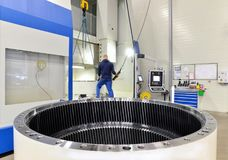 Factory of modern mechanical engineering - production of gearbox. Es for wind turbines - worker at cnc milling machine stock image