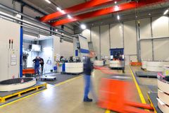 Factory of modern mechanical engineering - production of gearbox. Es for wind turbines - forklift truck transportation stock image