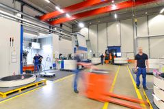 Factory of modern mechanical engineering - production of gearbox. Es for wind turbines - forklift truck transportation stock images