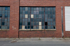 Factory with multicolor window panes Royalty Free Stock Images