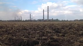 Factory near the field. Time lapse stock video