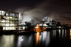 Factory at night. Night scene with a factory in an industrial area royalty free stock images