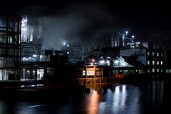 Factory at night. A night scene with a factory in an industrial area, blue version. This is the same factory you can find in my portfolio at night. There is a royalty free stock images