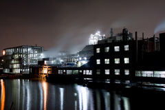 Factory at night. A night scene with a factory in an industrial area. This is the same factory you can find in my portfolio at night. There is a river and cargo stock images